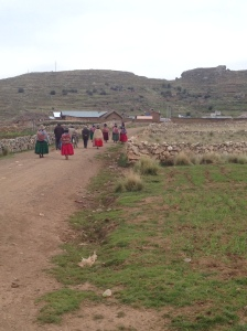 Women farmers returning to the village from the fields